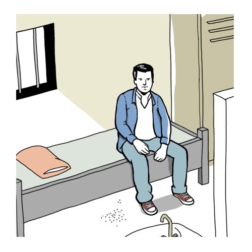 Mann alleine in einer Gefängniszelle
